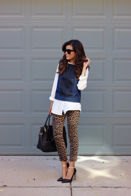 With white button down shirt, navy blue sleeveless shirt, black pumps and black bag