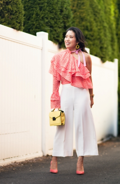 With white culottes, yellow mini bag and pink shoes
