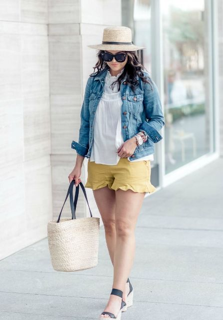 With white loose shirt, denim jacket, hat, platform sandals and tote bag