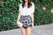 With white loose shirt, white mini clutch and black flats