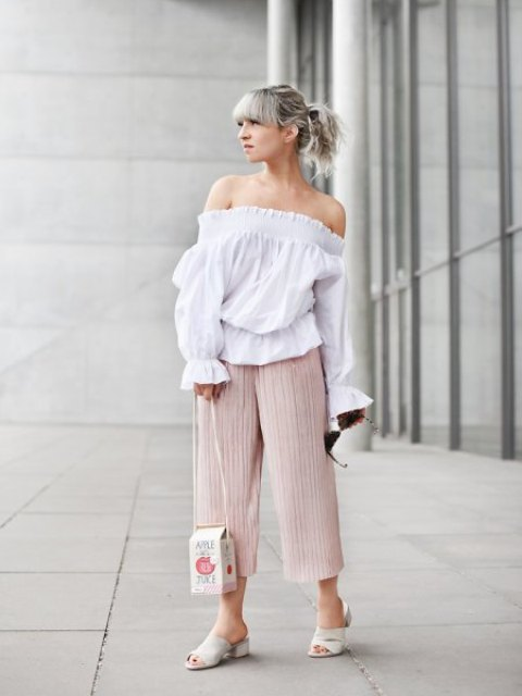 With white off the shoulder shirt, white mules and unique bag