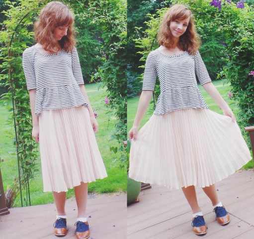 With white pleated skirt and golden and blue shoes