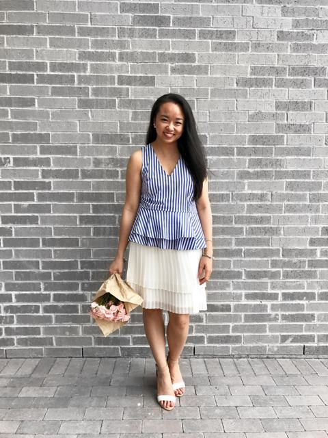 With white pleated skirt and white shoes