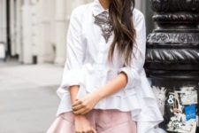 With white ruffled shirt, gray bag and necklace