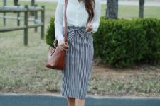 With white shirt, beige high heels and brown leather bag