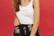 With white sleeveless blouse