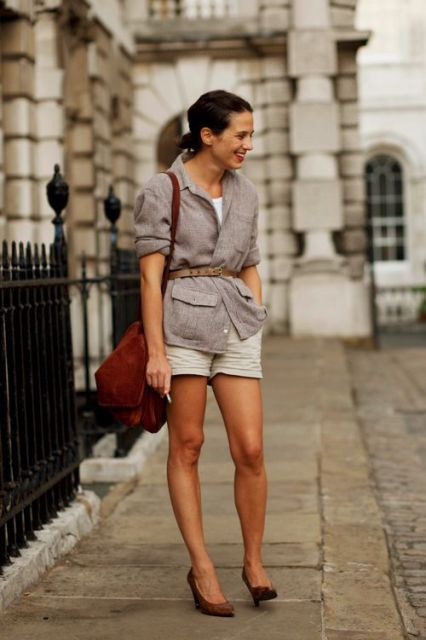 With white t shirt, beige shorts, shoes and marsala bag