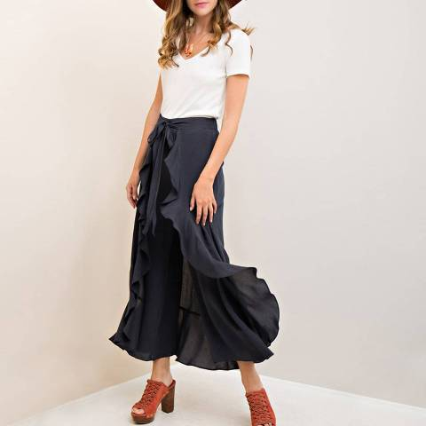 With white t shirt, marsala hat and brown platform sandals