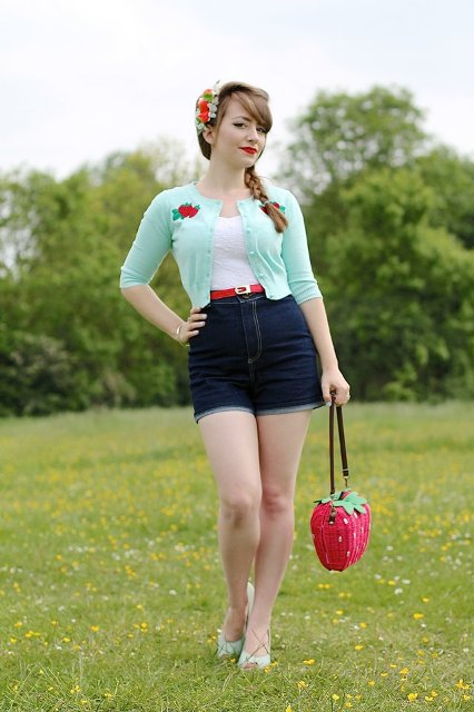 With white top, mint green crop jacket, denim shorts and white shoes