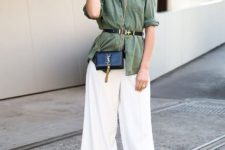 With white wide leg pants, mini bag, striped t-shirt and black high heels