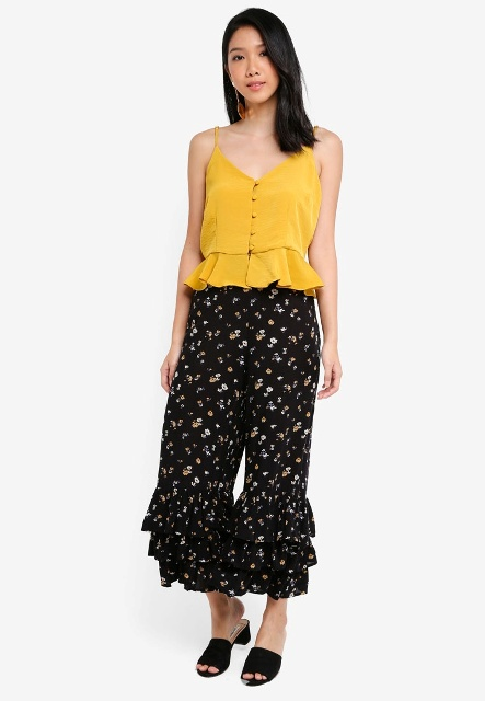 With yellow top and black shoes