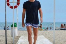 a navy t-shirt and blue and white horizontal stripe swim trunks are classics for any beaches