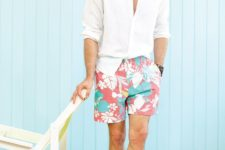 a white shirt and bright botanical print shorts plus blue sneakers will make you look fresh and vivacious