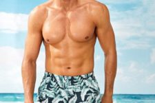 bright tropical leaf print swim trunks done in dark and bold green are amazing for tropical beaches