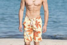 bright yellow and orange botanical print swim trunks with a retro feel are all the rage