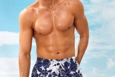 fun navy and white botanical print swim trunks feature a masculine color combo