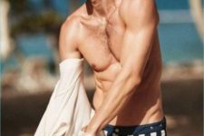 vertical stripe navy and white trunks show that effortless French chic that is so hot this year