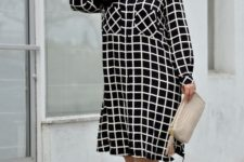 02 a black and white loose windowpane print midi dress with long sleeves, nude heels and a creamy clutch