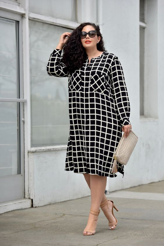 a black and white loose windowpane print midi dress with long sleeves, nude heels and a creamy clutch