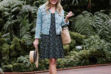 02 a black floral knee dress, a blue denim jacket, black lace up sandals, a straw bag and hat