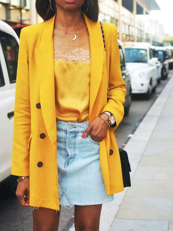 a bleached denim mini, a yellow lace top, a yellow oversized blazer and a black bag for a bright summer look