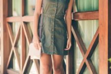 02 a green mini dress with brown buttons and thick straps plus white strappy shoes and a matching bag