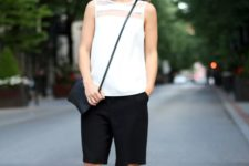 02 a minimalist office look with a sleeveless white top, long black shorts, neutral shoes and a navy cross body bag