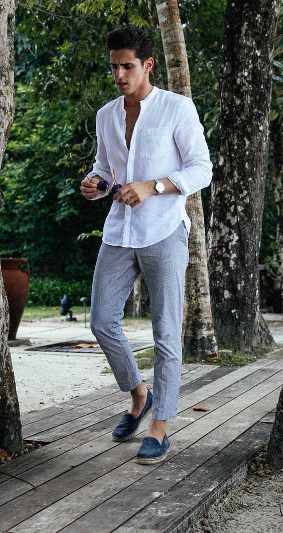 a relaxed summer party look with a white linen shirt, grey pants, blue espadrilles