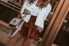 02 a white denim jacket, a white tee, cognac ruffle shorts, white mules and a blush bag