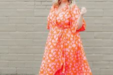 03 a bright orange wrap midi dress with a floral print and an asymmetrical skirt and sheer heels