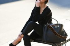 03 a chic black laptop bag with a wide printed long handle is a stylish and comfy idea