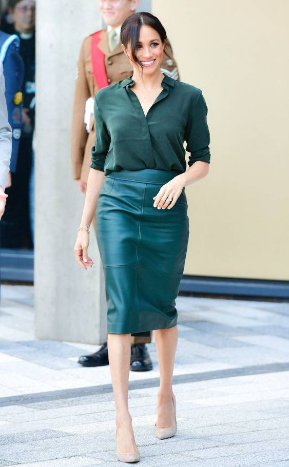a dark green shirt, a teal pencil midi skirt, nude shoes by Meghan Markle
