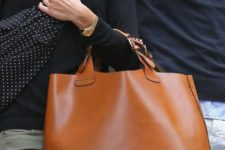 03 a large amber leather catch all tote with short yet comfortable handles is a timeless accessory to rock