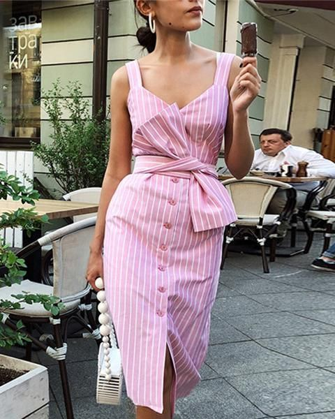 a pink and white striped fitting dress with a button row and a geometric cut looks retro and feminine