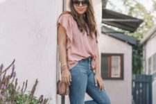 03 a pink loose top, blue raw hem flare jeans, black espadrilles and a brown bag