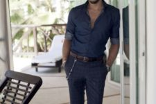 03 a relaxed summer outfit with a chambray shirt, navy printed pants and brown moccasins with tassels