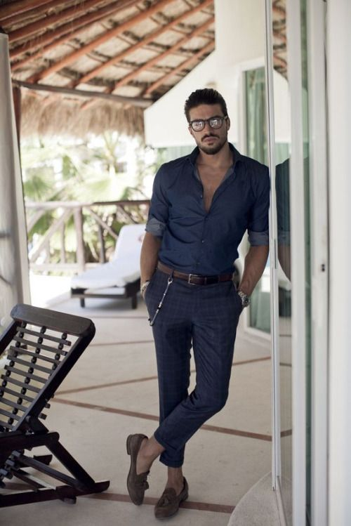a relaxed summer outfit with a chambray shirt, navy printed pants and brown moccasins with tassels
