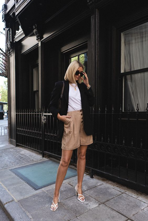 a stylish office look with camel long shorts, a white tee, layered necklaces, a black blazer and white strappy shoes