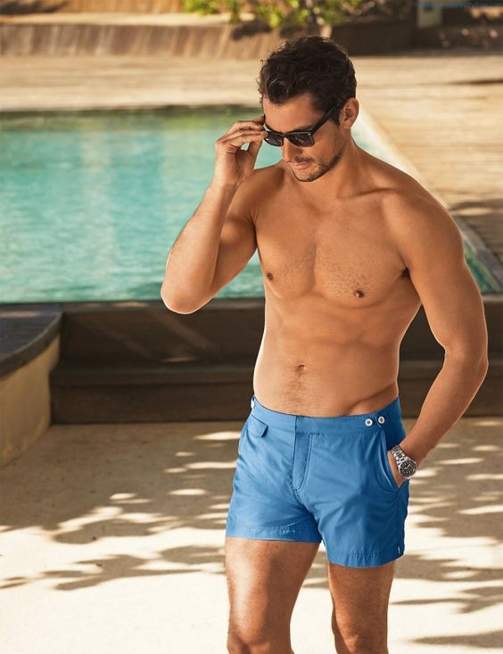 bright blue swim trunks with a vintage design is a hot and trendy option to rock this summer