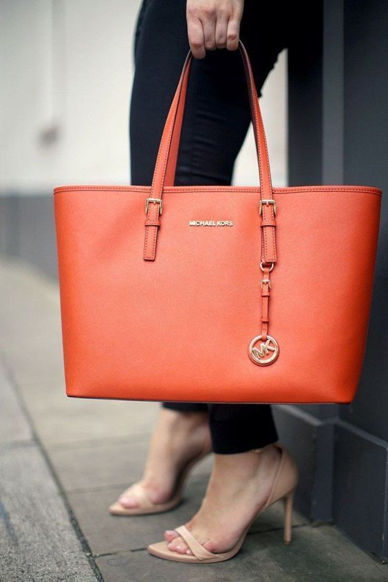 a bright orange laptop tote with a simple and elegant design will make a statement with its color
