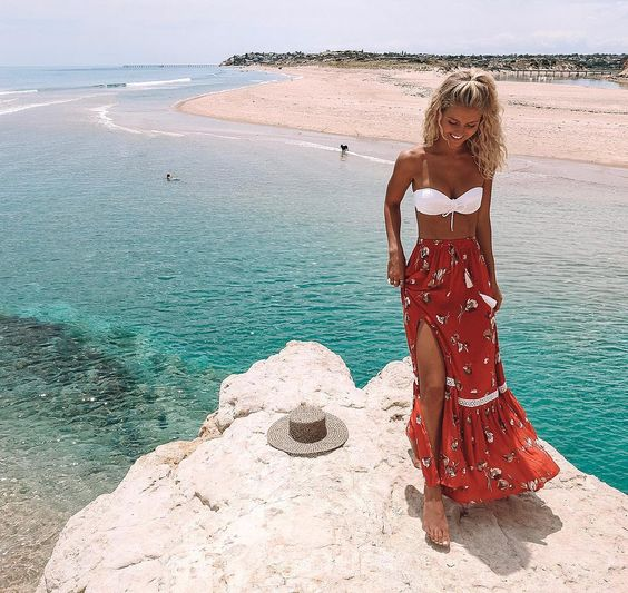 a colorful floral maxi skirt with a side slit perfectly matches the swimsuit and looks gypsy