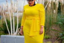 04 a fitting yellow midi dress with long sleeves and a sash plus leopard printed shoes and tassel earrings