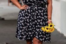 04 a moody floral wrap knee dress is spruced up with bright yellow heels for a colorful and chic touch
