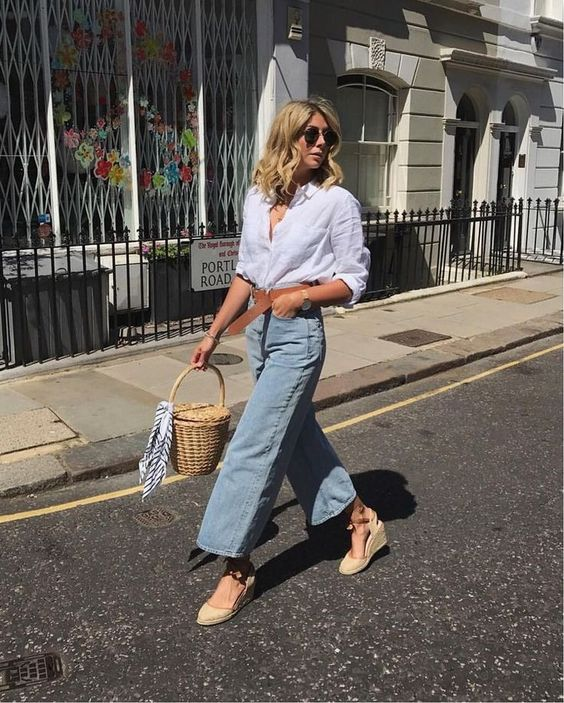 a white shirt, blue straight jeans, espadrilles and a wicker basket bag for a cozy transitional look