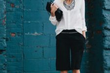 04 a white shirt, layered necklaces, black long shorts, black strappy shoes and a bag