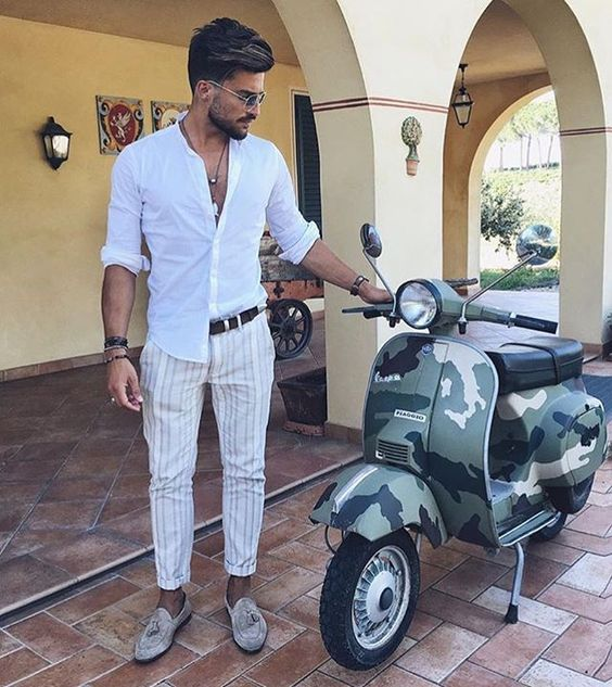 a white shirt, striped pants, neutral loafers with tassels for a relaxed summer outfit look