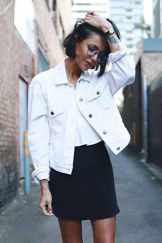 a white tee, a black mini and a white denim jacket is a ready office look with a touch of summer