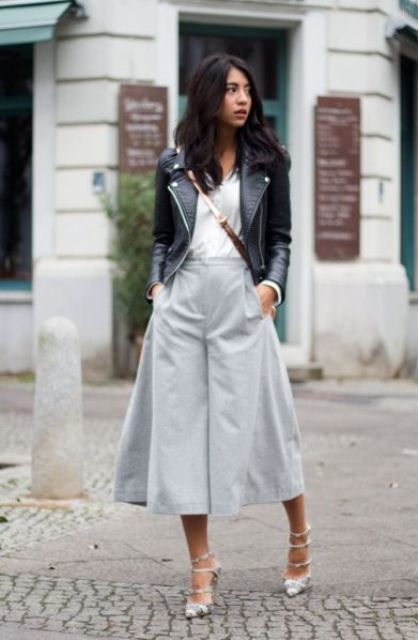 a chic look with a white shirt, grey culottes, snake print shoes and a black leather bag