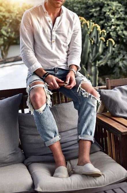a linen shirt, blue distressed jeans, white espadrilles for an effortlessly chic and relaxed look