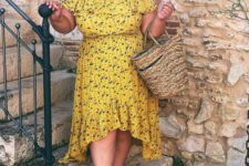 05 a mustard off the shoulder floral midi dress with a high low skirt, black lace up shoes and a wicker bag